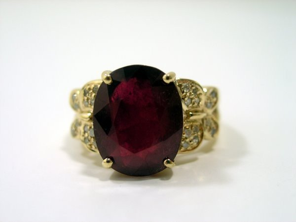 17: 14KT Y.G. RUBY AND DIAMOND RING 7.30CT