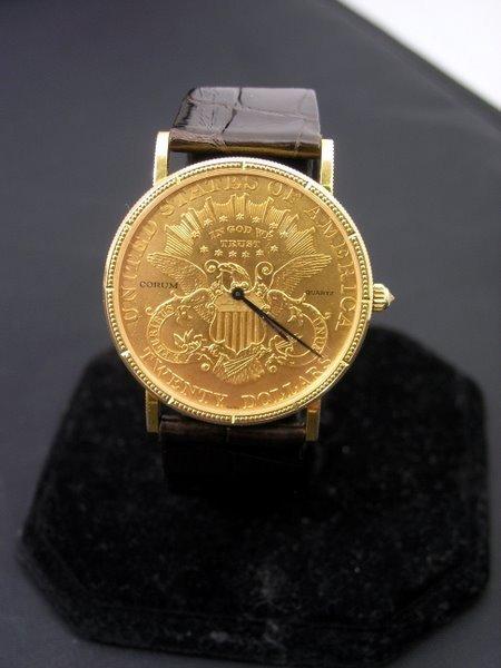 25: 18KT Y.G. CORUM $20.00 GOLD WATCH