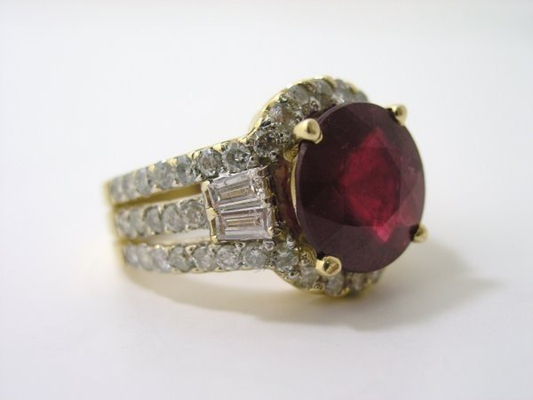 19: 14KT Y.G. RUBY AND DIAMOND RING 7.50CT