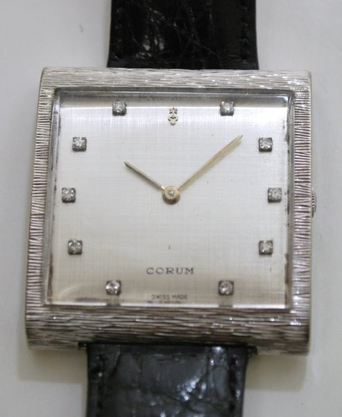 19: 18KT W.G. CORUM BUCKINGHAM