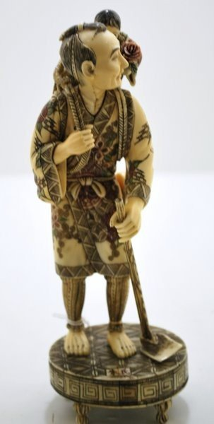 4: IVORY FIGURE MAN AND CHILD