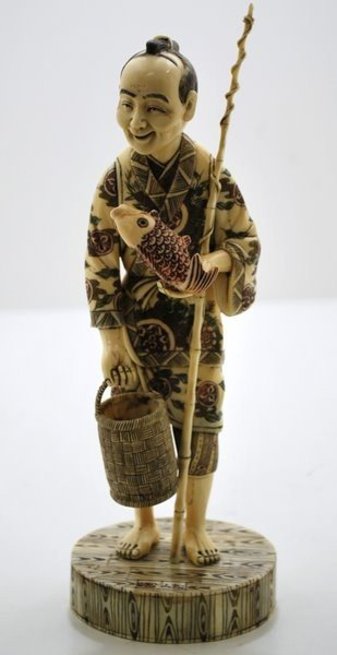 17: IVORY CARVING OF A FISHERMAN