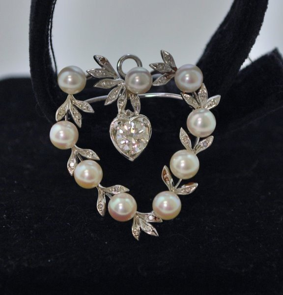 21: 14KT W.G. PEARL AND DIAMOND PENDANT .60CT