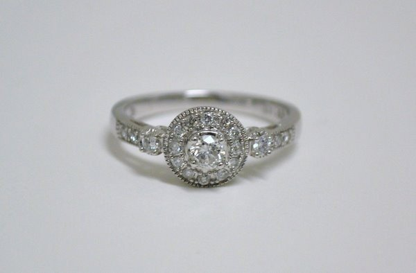 9: 14KT W.G. .50CT DIAMOND RING