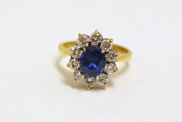 16: LADYS 18KT SAPPHIRE & DIAMOND RING