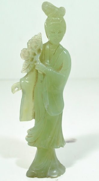5: JADE CARVING OF A WOMAN HOLDING FLOWERS