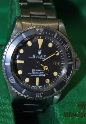 114: ROLEX SEADWELLER REF 1665 BOX AND PAPERS