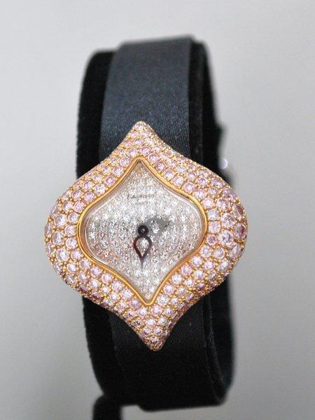 60: LADIES 18KT CHOPARD PINK & WHITE DIAMOND WATCH