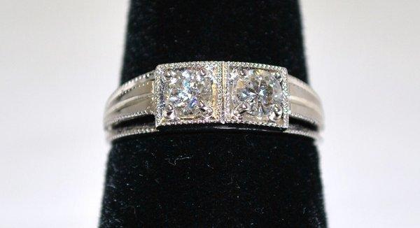 11: LADIES 14KT W.G. .60CT DECO DIAMOND RING