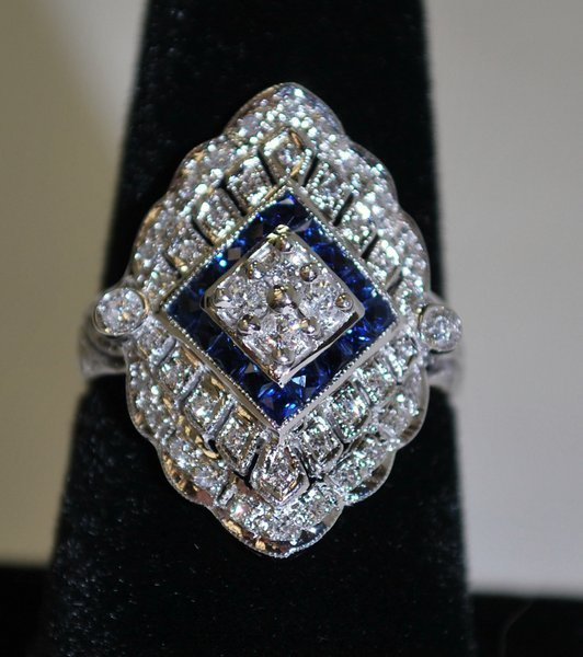 4: 14KT W.G. SAPPHIRE AND DIAMOND RING