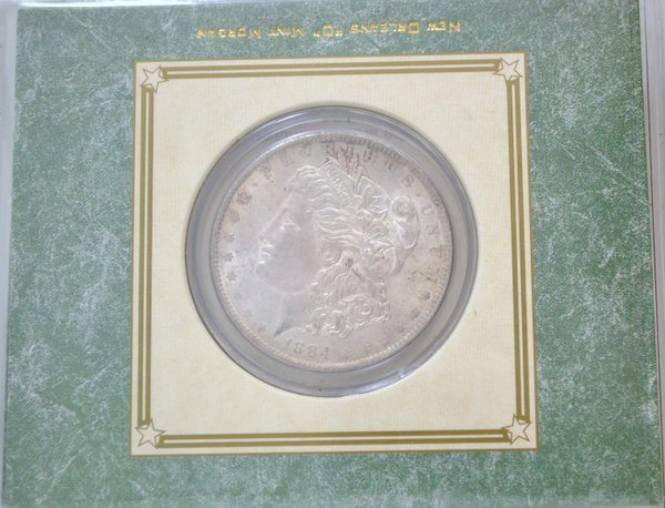 107: 1884-O MORGAN SILVER DOLLAR