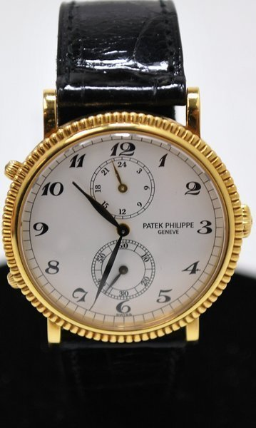 36: 18KT Y.G. PATEK PHILIPPE TRAVEL TIME