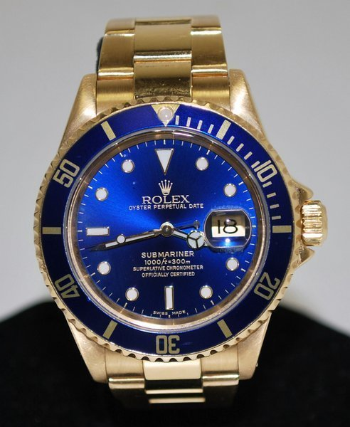 29: 18KT Y.G. MENS ROLEX SUBMARINER BOX AND PAPERS