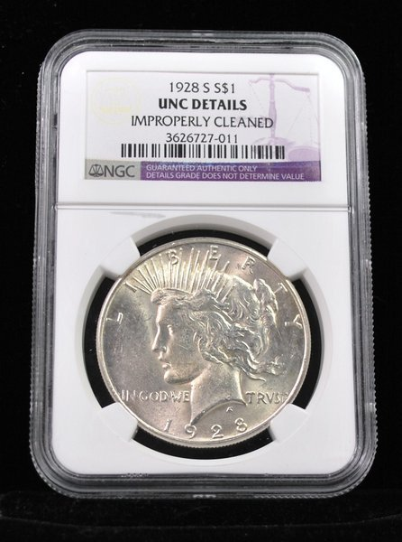 1928 PEACE SILVER DOLLAR UNC CLEANED NGC