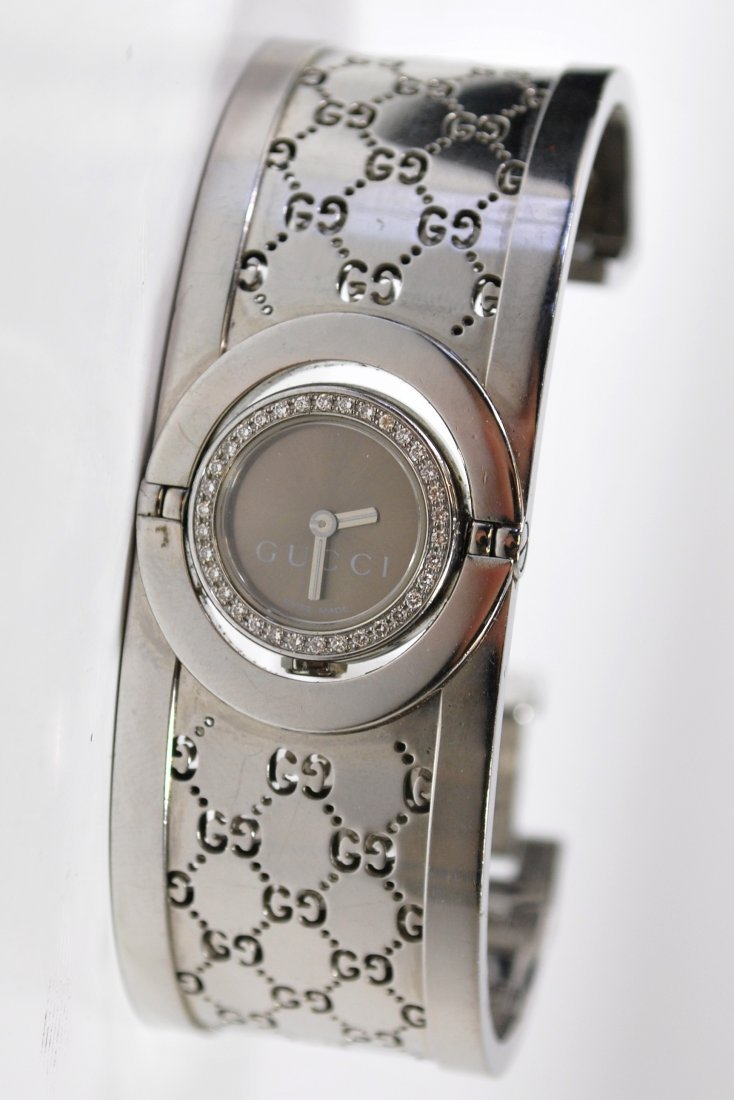 LADIES S/S GUCCI DIAMOND CUFF WATCH