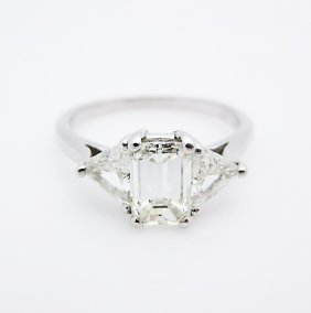 Platinum Emerald Cut And Triangle Diamond Ring