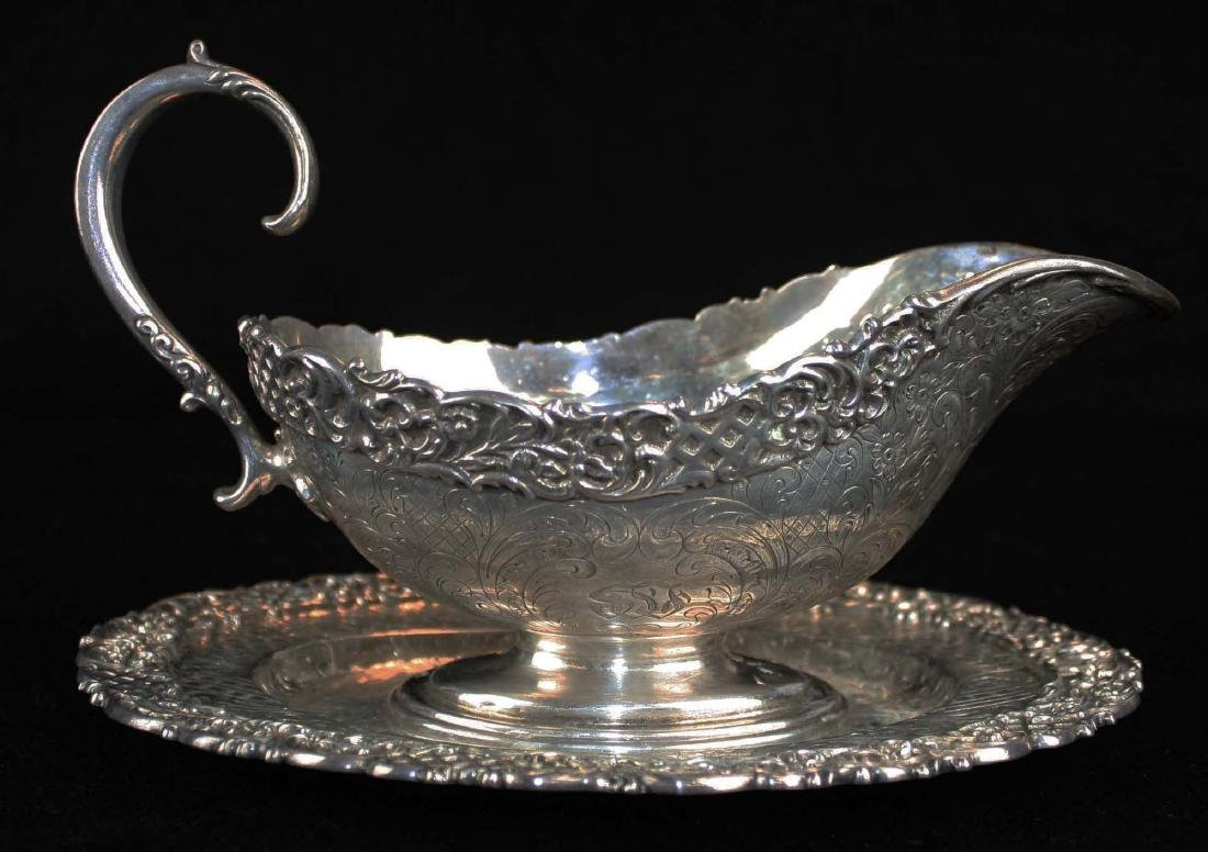 ornate late Victorian sterling silver  gravy boat with
