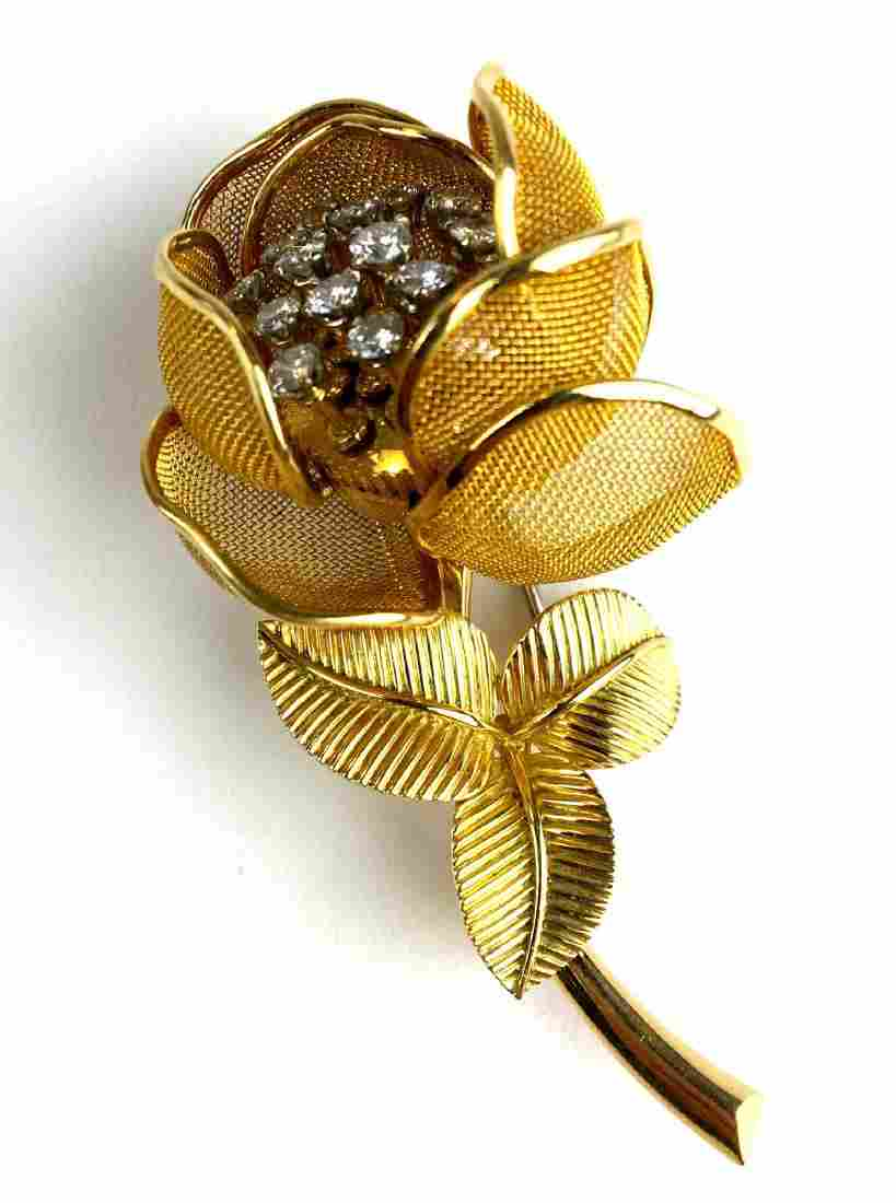18 K Yellow gold jointed floral diamond pin.