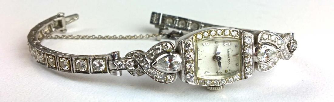 Fine ladies diamond and platinum wrist watch.