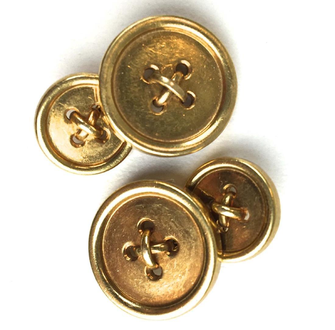 Tiffany men's 14k yellow gold button design cuff links.