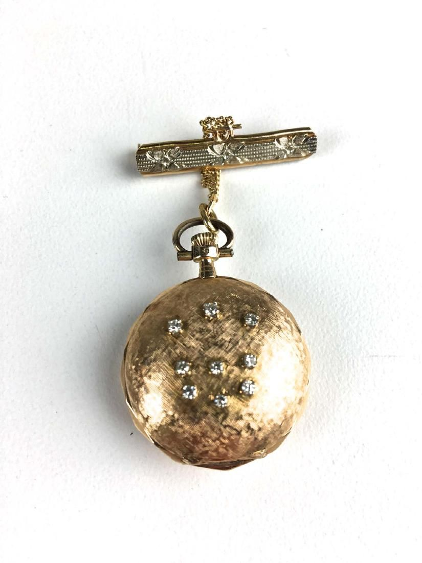 Ladies 14k y.g and diamond pendant watch with bar pin.