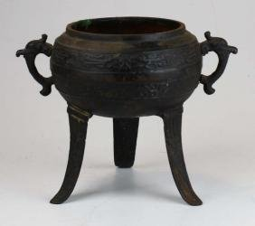 Ancient Chinese bronze three footed bowl with dragon