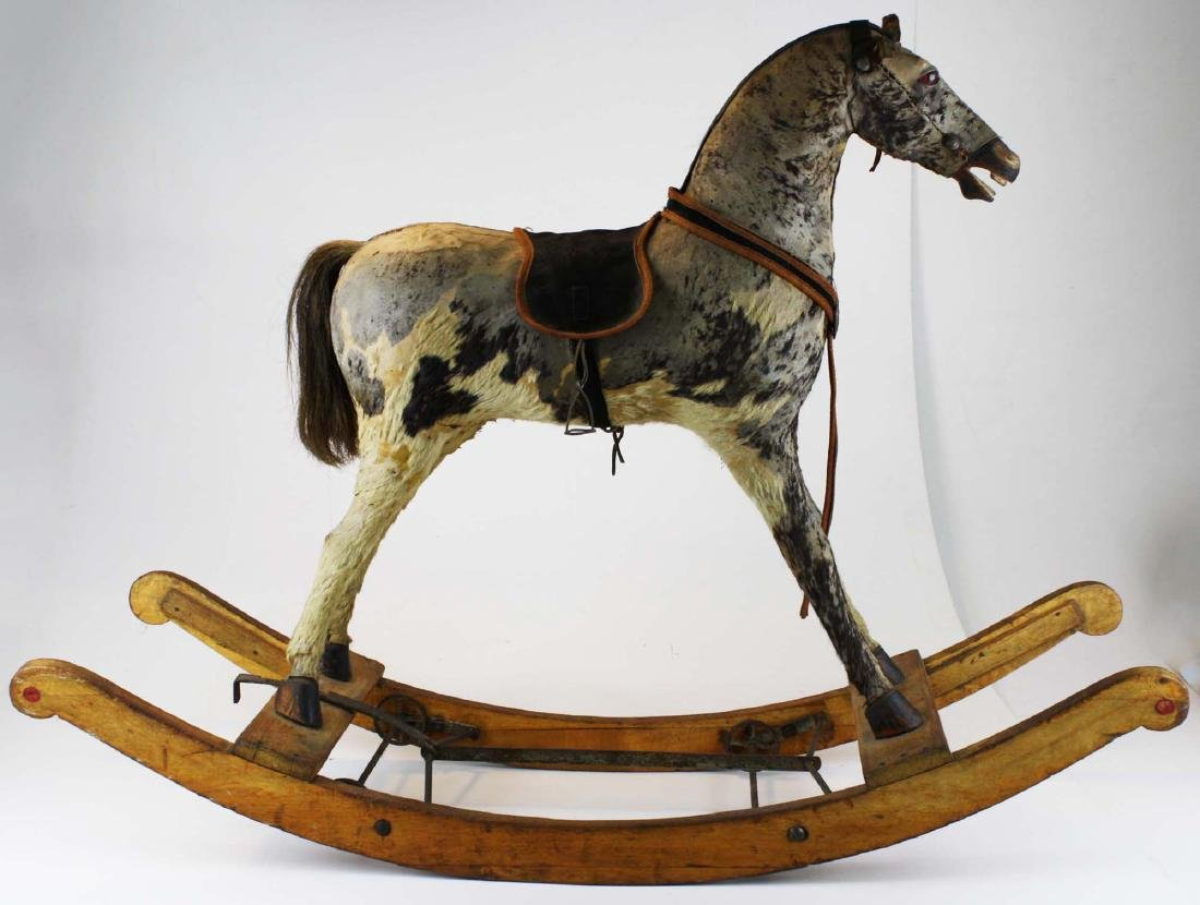 late 19th c hide horse rocking horse with wheels