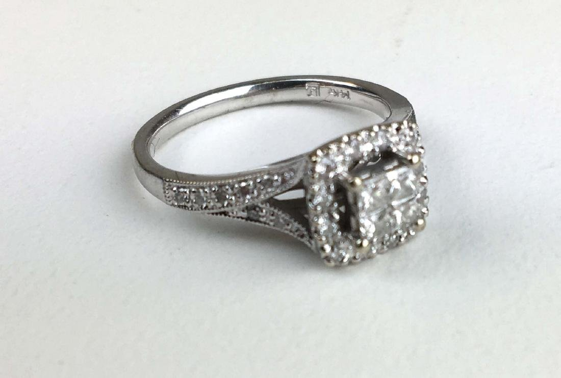 14k white gold and diamond ladies ring.