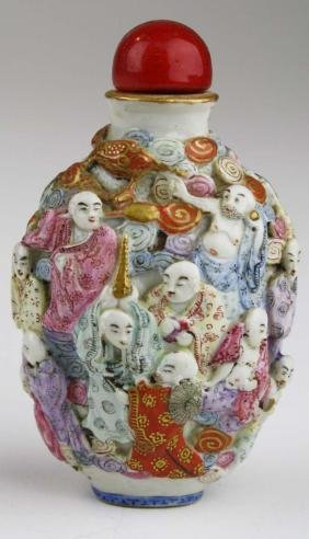 Chinese antique relief enameled porcelain snuff bottle
