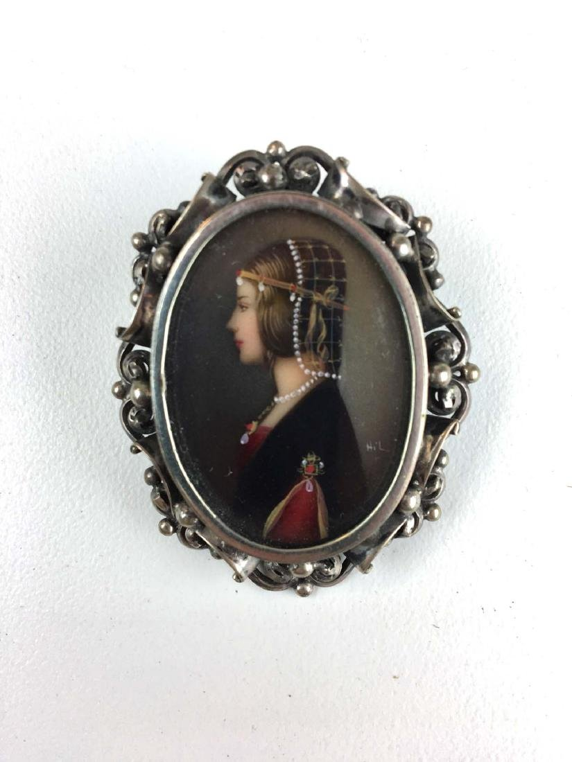 Fine oval minature oil female portrait in silver frame.