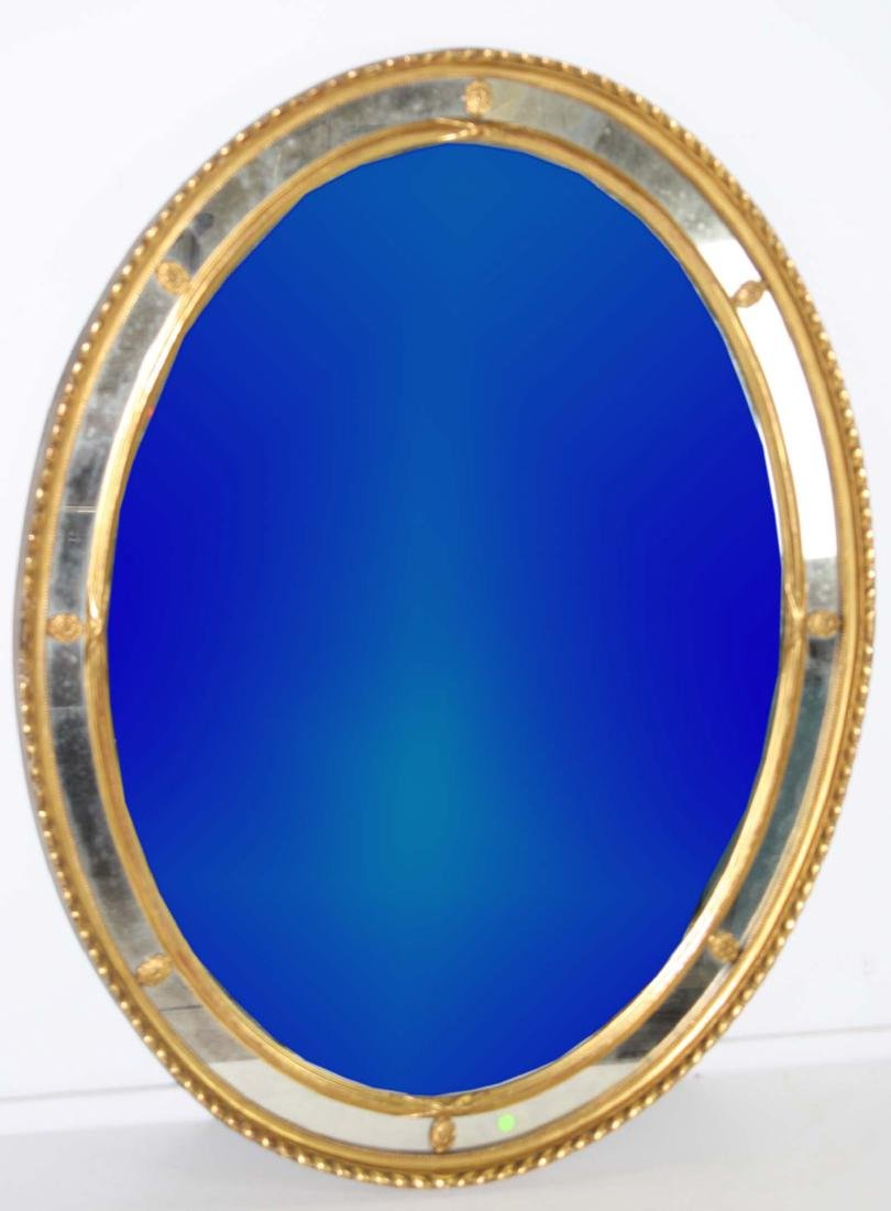 early 20th c oval gilt mirror
