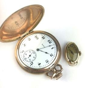 Two watches, 14k y.g. oval ladies case wrist watch &