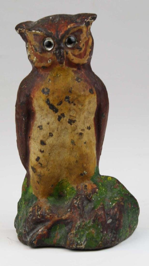 early 20th c owl cast iron doorstop w/ glass eyes