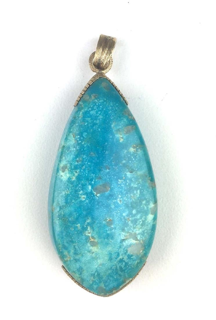 14k y.g and turquoise pendant.