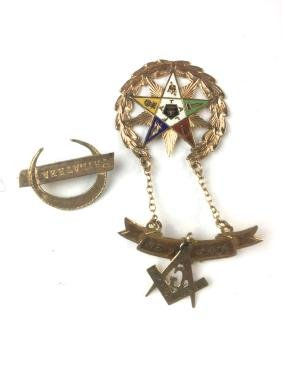 Two fraternal Masonic pins.