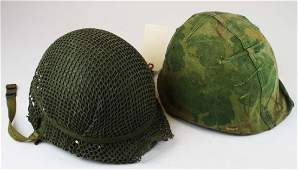 2 US Vietnam War era helmets