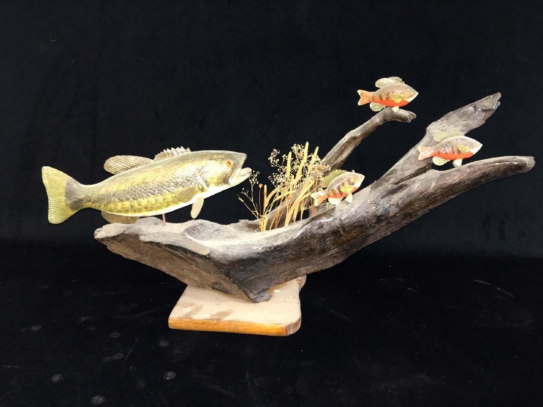 Rupert King Jr Carving of bass and 3 sun fish.