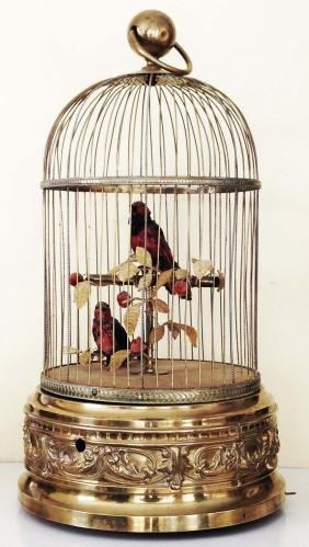 Singing bird automatons in fancy brass cage