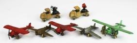 7 Tootsie Toy trucks & airplanes