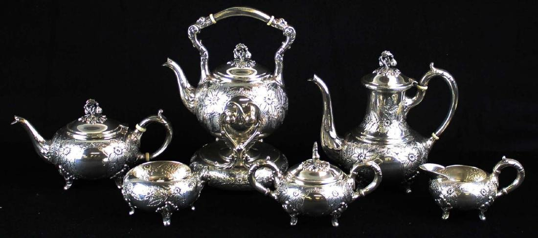Floral repousse sterling silver tea set