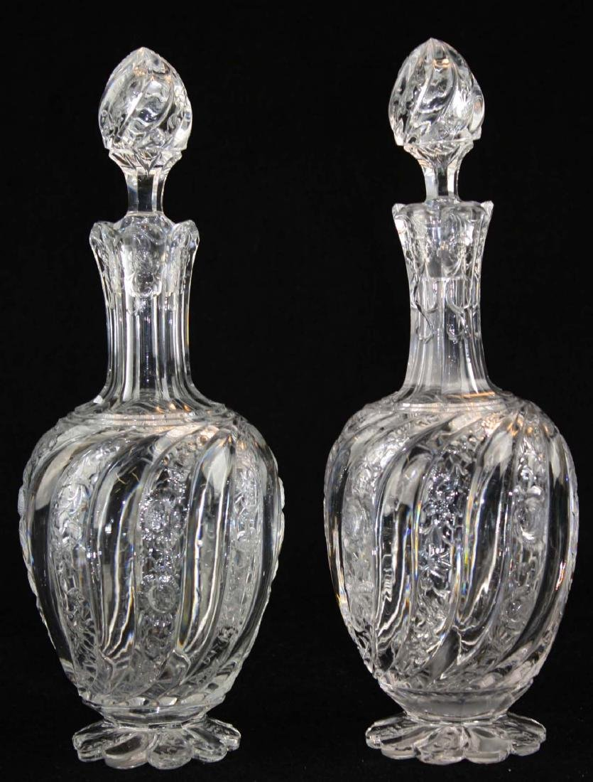 Pair of intaglio swirl cut glass decanters