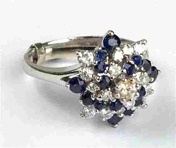 14 k w g diamond & sapphire swirl form ring