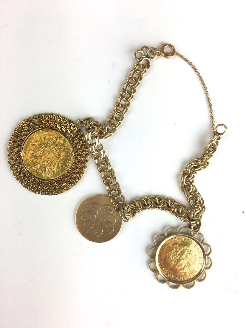 14k y g charm bracelet with two gold coins