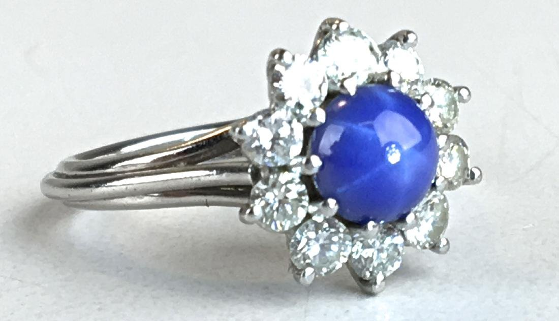 Diamond, star sapphire & white gold ladies ring