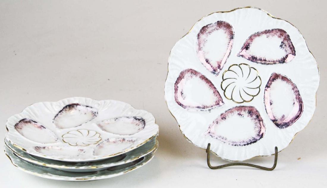 4 porcelain oyster plates