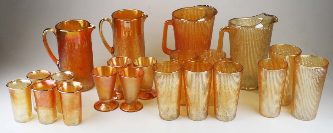 4 Carnival glass pitcher and 17 tumblers