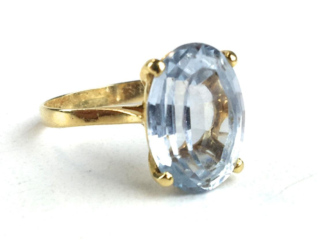 18 k yellow gold and aqua marine ladies ring.