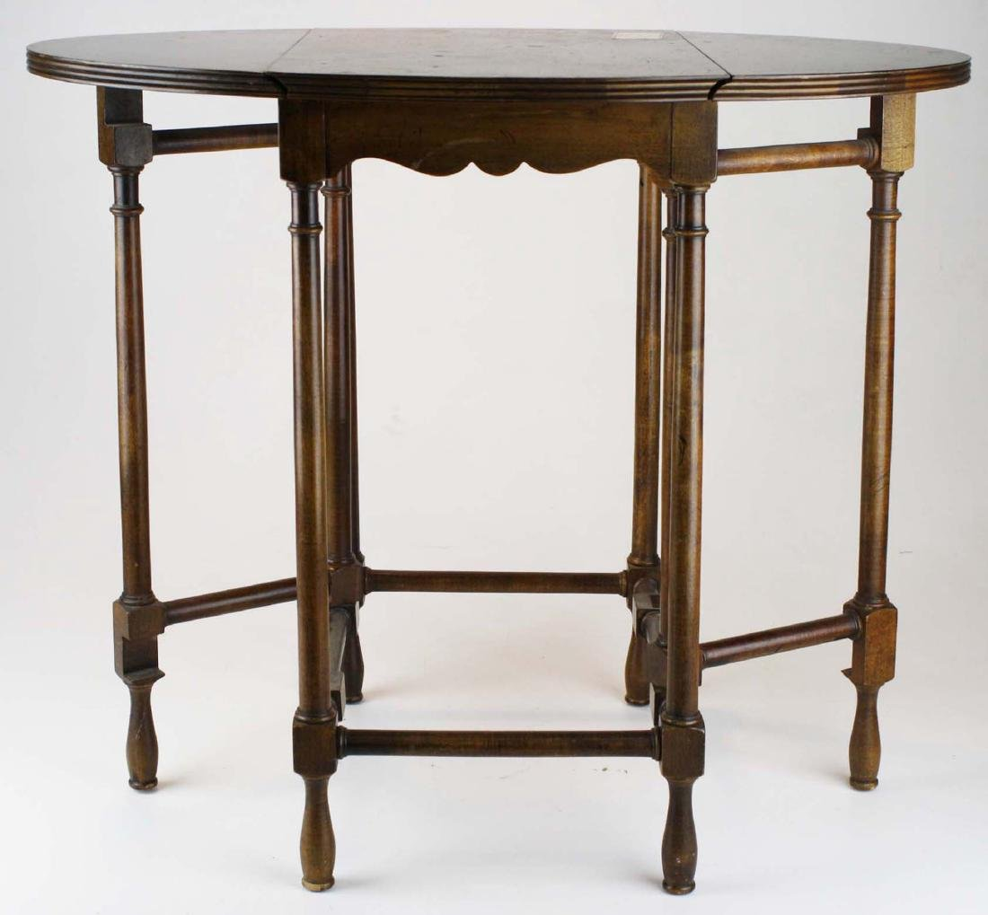 delicate Baker Furniture burl veneer drop leaf stand