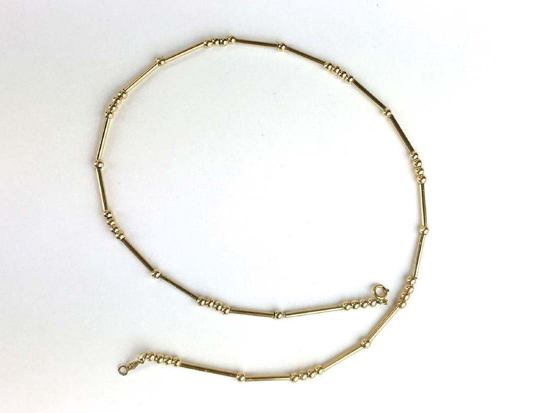 14 k yellow gold necklace with beads and tube