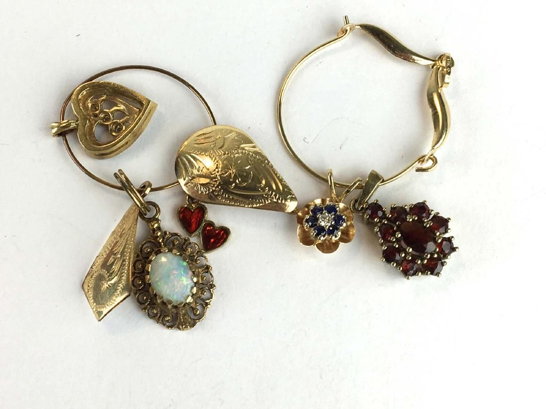 Group of 6 gold charms or pendants.